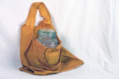 orange oval handle tote bag