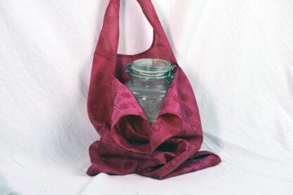 pink oval handle tote bag
