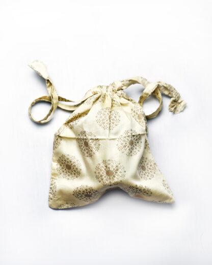 small drawstring bag ivory and gold