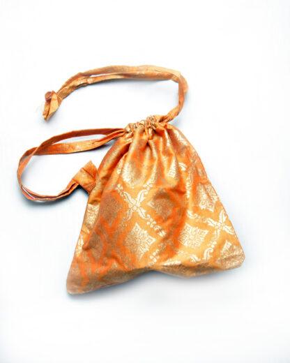 small drawstring bag orange and gold