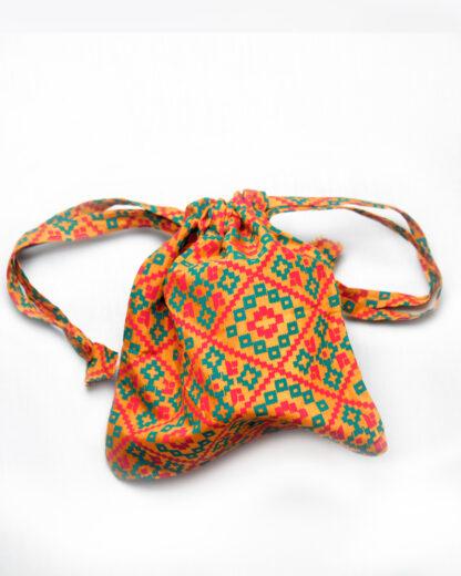 small drawstring bag orange tribal