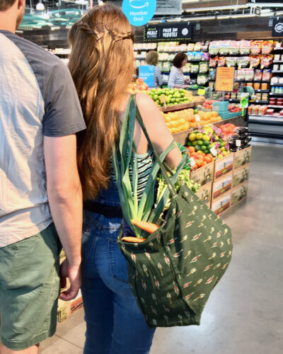 tote bag with pockets vegetables in whole foods store