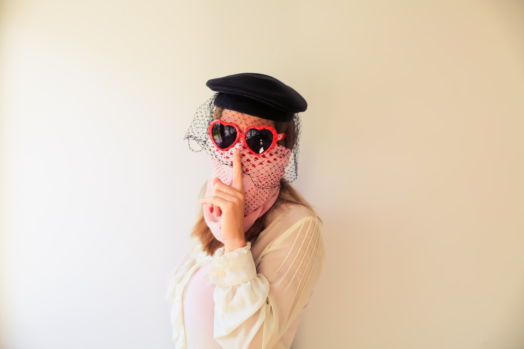 woman with bandana and heart glasses