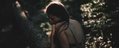 child in dark forest